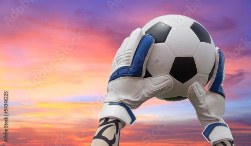 Soccer goalkeeper's hands reaching for the ball