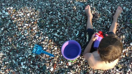Boy Playing with toys near the seaside