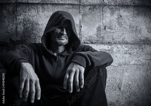 Solitary man in a hood