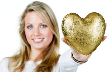 young woman shows a golden heart
