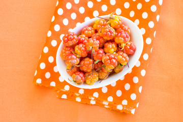 Cloudberries on orange napkin