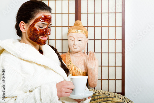 young woman with chocolate face mask