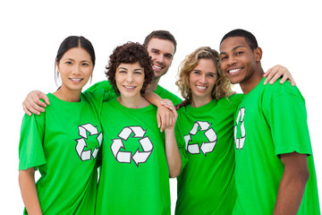 Group of people wearing green shirt with recycling symbol on it