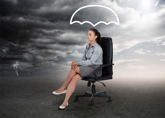 Umbrella graphic above the head of a businesswoman