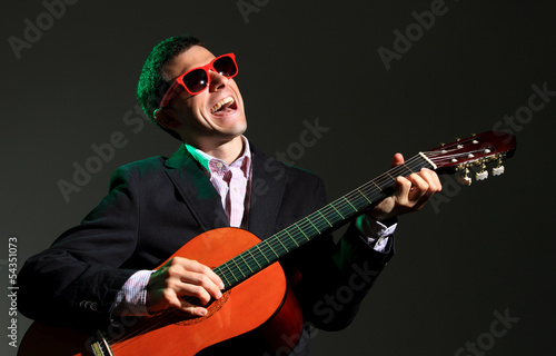 Guitar player on black background