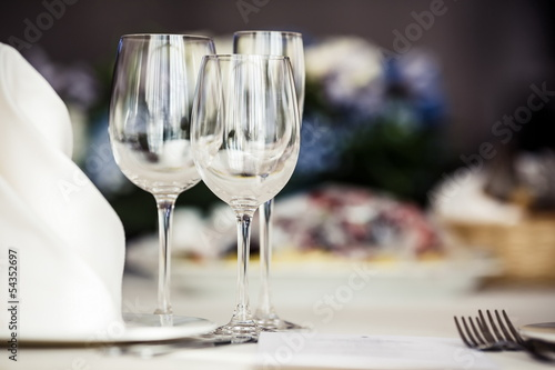 Empty glasses set in restaurant - 54352697