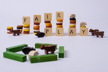Fair play game - wooden column on white background.