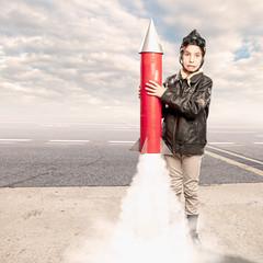 little aviator holding a rocket