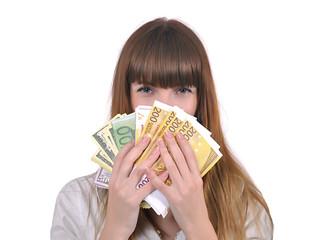 девушка закрывает лицо деньгами