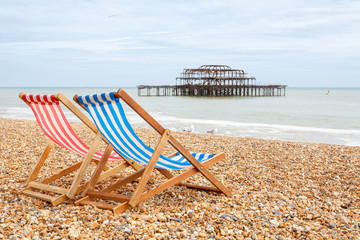 Deckchairs on Brighton beach. Brighton, England