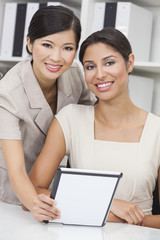 Asian Chinese & Hispanic Businesswomen Using Tablet Computer