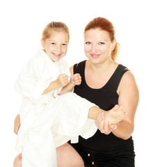 Sports family mom teaches daughter to beat kick insulated