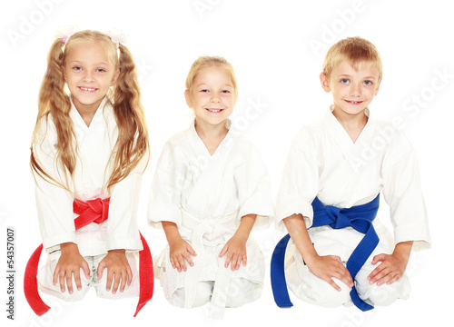 Young children to sit in a ceremonial kimono karate pose