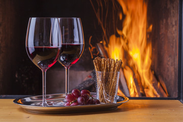 delicious wine, drinks and snacks at fireplace