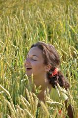 happy girl in wheat