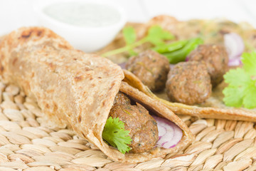 Kati Roll - Kofta and red onion in a paratha fried with eggs