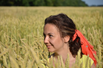 girl in a yellow vest in wheat
