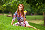 Girl with apple at outdoor