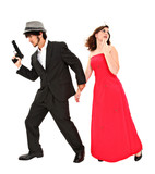 Attractive young couple with gun running in fear with clipping p
