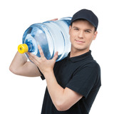 Water delivery. Cheerful young deliveryman holding a water jug w