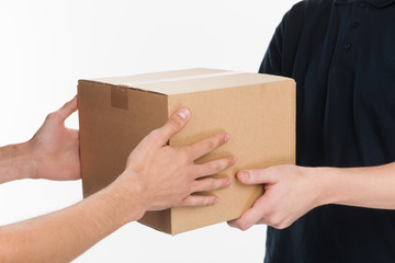 From hands to hands. Close-up of hands holding cardboard box whi