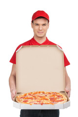 Pizza delivery. Cheerful young deliveryman holding a pizza box w