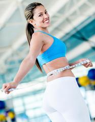 Gym woman taking measurements
