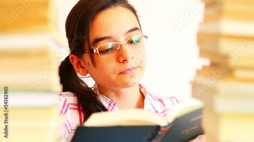 Teen girl with lot of books reading