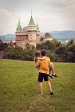 Loving couple looking at castle