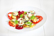 Mango, tomato, beetroot and cucumber salad with fresh cheese