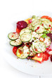 Cucumber salad with tomatoes, beets,cottage cheese and herbs