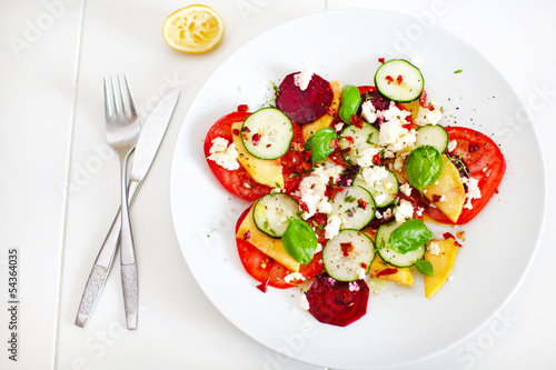 Summer salad of mango, tomato, beetroot, cucumber and feta