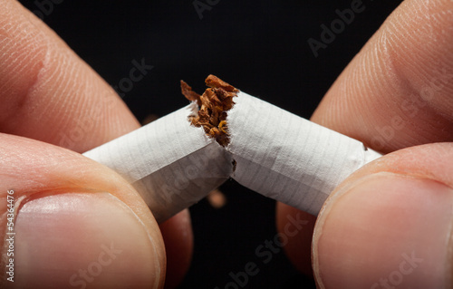 Hand Breaking Cigarette