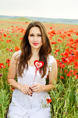girl with heart in field