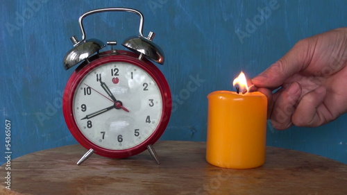 clock arrow motion and candle flame. Time concept