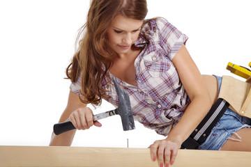 Junge Frau als Handwerkerin