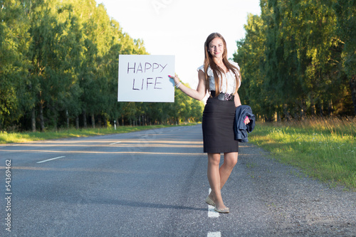 Woman hitchhikes for happy life