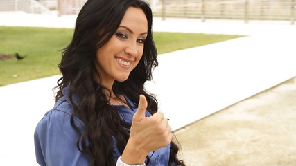 Happy business woman with thumbs up gesture of success
