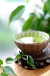 Healthy green tea cup with leaves