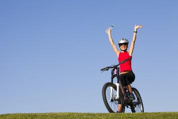 woman having fun on a bicycle