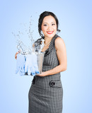 Attractive young woman holding cleaning equipment