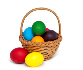 Easter eggs in basket over white