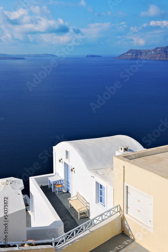 Whitewashed villa overlooking the caldera in Oia