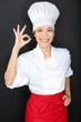 Chef woman giving a Perfect gesture with hand