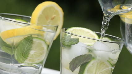 Glass with lemonade and jug