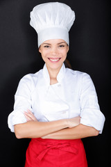 Asian female chef in chef whites uniform and hat
