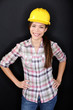 Construction worker or engineer portrait on black