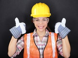 Construction worker thumbs up happy woman portrait