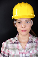 Construction worker with glasses and hardhat