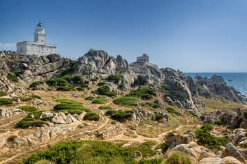 Coastline and lighthouse in Capo Testa, Sardinia, Italy